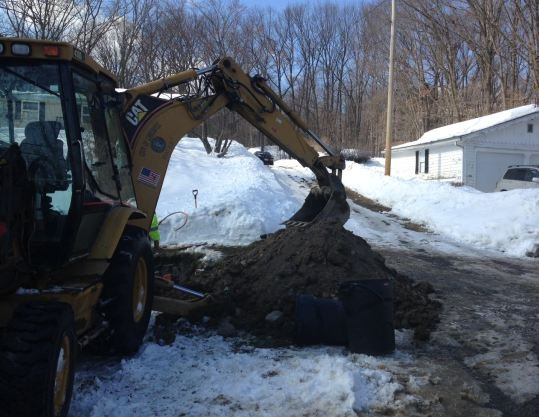 Water Department crews work on Granby Road in Chicopee. One of many problems called in during the last few weeks. (CBS 3 / Hugh Zeitlin)
