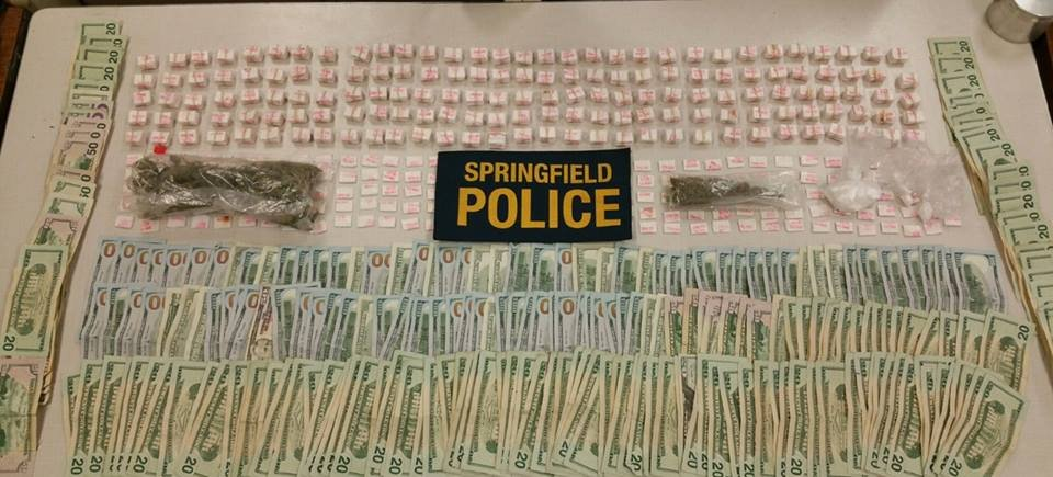 Police seized more than $12,000 and 1,700 bags of heroin from an alleged drug trafficker residing in Chicopee. (SPD)