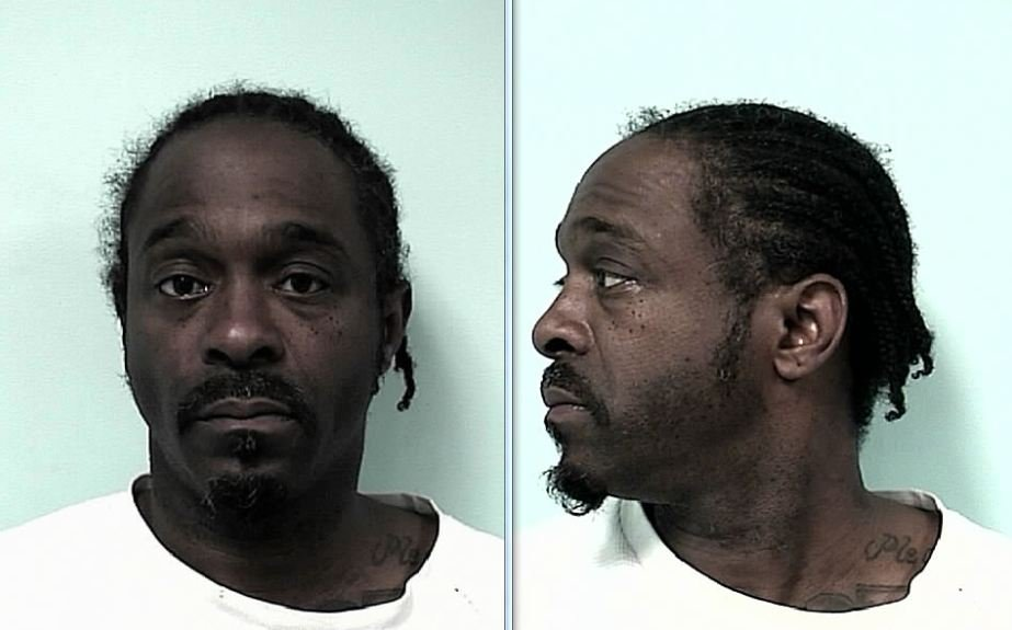 Mug shots of Erick Buchanon, who is accused of murdering a 29-year-old woman back on March 11. (SPD)