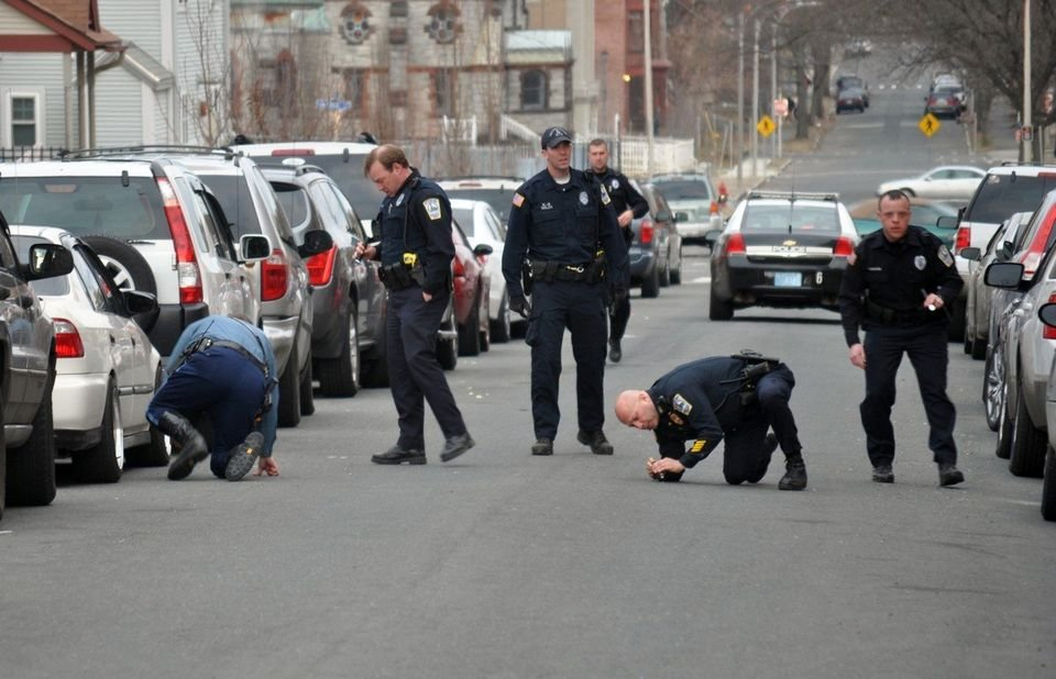 State and local police search for evidence on Chestnut Street in Holyoke after a 30-year-old man was shot on Easter Sunday. (MassLive / The Republican)