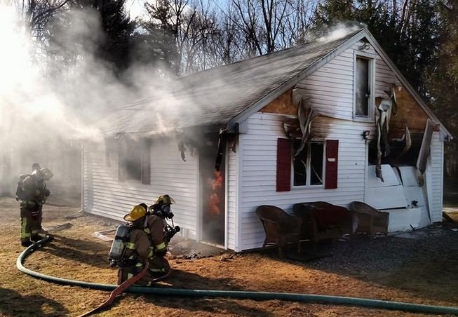 Firefighters battle a garage fire in Southwick on Saturday morning. (Southwick Police Department)