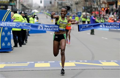 Caroline Rotich, of Kenya, breaks the tape to win the women's division of the Boston Marathon, Monday, April 20, 2015 in Boston. (AP Photo/Elise Amendola)
