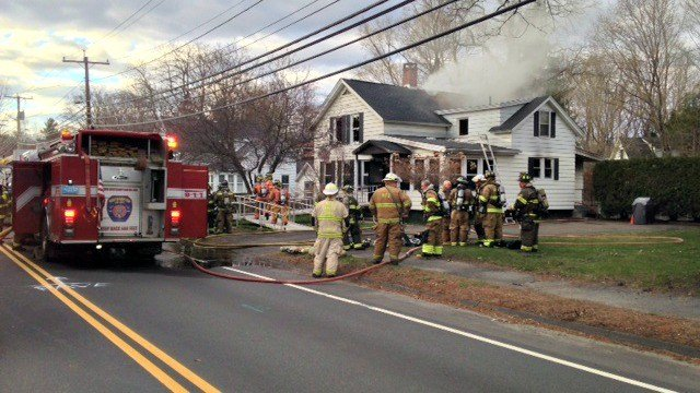 Crews work to extinguish a house fire in Florence