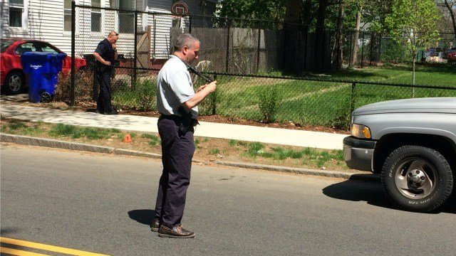 Investigators check for evidence at the shooting scene