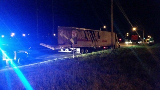 A big rig crashed into several other trucks and a Motel 6 Wednesday night.