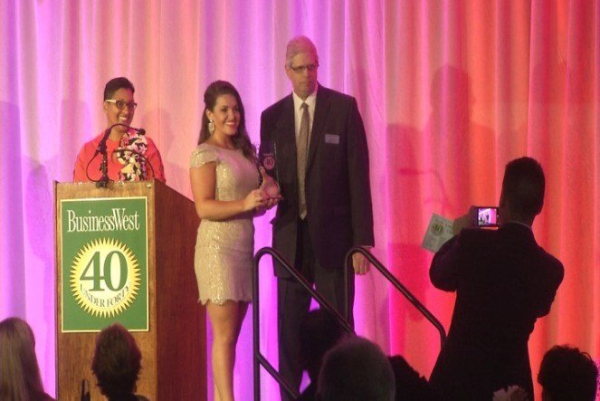 Western Mass News anchor Cherise Leclerc receives an award at the 40 Under Forty Gala at the Log Cabin Thursday night.