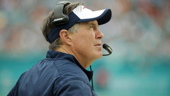 New England Patriots head coach Bill Belichick looks at the scoreboard during the first half of an NFL football game against the Miami Dolphins, Sunday, Jan. 3, 2016, in Miami Gardens, Fla. (Source: AP/Lynne Sladky)